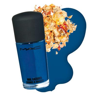 Nail polish with gold flakes.