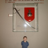 Erand in front of the replica set of Skenderbeu`s sword and helmet.